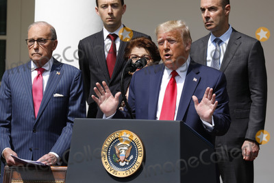 The National Photo - United States President Donald J Trump delivers remarks before signing HR 7010 - PPP Flexibility Act of 2020 in the Rose Garden of the White House in Washington DC on June 5 2020  Pictured at left is Director of the National Economic Council Larry Kudlow and at right is US Secretary of Labor Eugene ScaliaCredit Yuri Gripas  Pool via CNPAdMedia