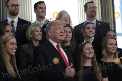Queen Photo - United States President Donald J Trump poses with athletes from the Queens University Charlotte Swim Team as part of NCAA Collegiate National Champions Day at the White House in Washington on November 22 2019 Credit Yuri Gripas  Pool via CNPAdMedia