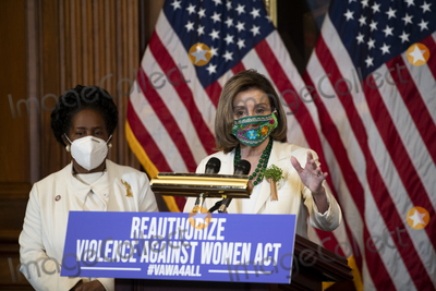 Representative Nancy Pelosi Photo - United States Representative Sheila Jackson-Lee (Democrat of Texas) left listens while Speaker of the United States House of Representatives Nancy Pelosi (Democrat of California) offers remarks at a press conference regarding the Violence Against Women Act at the US Capitol in Washington DC Wednesday March 17 2021 Credit Rod Lamkey  CNPAdMedia