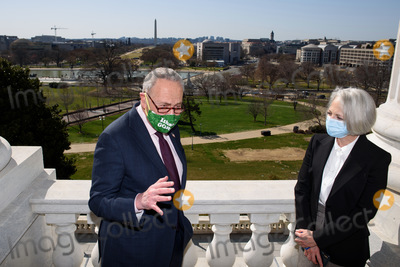 The Used Photo - United States Senate Majority Leader Chuck Schumer (Democrat of New York) speaks while posing for a photo with the new US Senate Sergeant At Arms Karen Gibson on the balcony outside Schumers office at the US Capitol in Washington DC on March 22 2021 Credit Mandel Ngan  Pool via CNPAdMedia