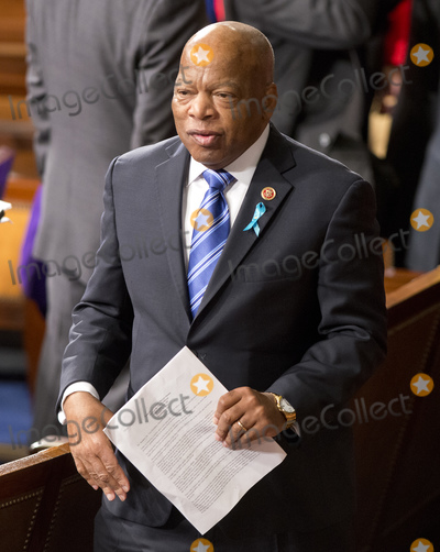 Barack Obama Photo - United States Representative John Lewis (Democrat of Georgia) departs the House chamber with a copy of US President Barack Obamas State of the Union Address that was delivered to a Joint Session of Congress in the US Capitol on Tuesday January 28 2014Credit Ron Sachs  CNP(RESTRICTION NO New York or New Jersey Newspapers or newspapers within a 75 mile radius of New York City)AdMedia