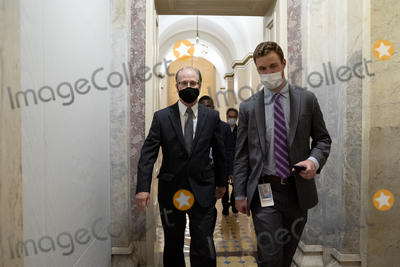 Donald Trump Photo - Senator Mike Braun a Republican from Indiana left wears a protective mask while walking through the US Capitol in Washington DC US on Saturday Feb 13 2021 The Senate voted to consider a request for witnesses at Donald Trumps impeachment trial injecting a chaotic new element that could end up prolonging proceedings that appeared to be on track to wrap up todayCredit Stefani Reynolds - Pool via CNPAdMedia