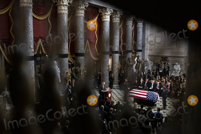 Elijah Cummings Photo - United States Senate Minority Leader Chuck Schumer (Democrat of New York) center speaks near the American flag-draped casket of US Representative Elijah Cummings (Democrat of Maryland) during a memorial service in National Statuary Hall at the US Capitol in Washington DC US on Thursday Oct 24 2019 Cummings a key figure in Democrats impeachment inquiry and a fierce critic of US President Donald J Trump died at the age of 68 on October 17 due to complications concerning long-standing health challenges Credit Al Drago  Pool via CNPAdMedia