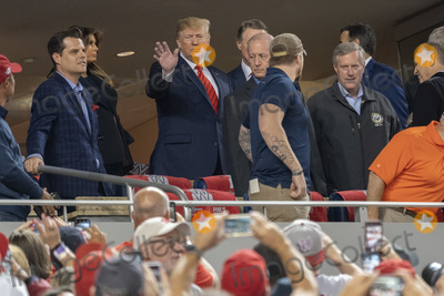 TI Photo - United States President Donald J Trump and First lady Melania Trump attend game five of the World Series at Nationals Park in Washington DC on October 27 2019 The Washington Nationals and Houston Astros are tied at two games going into tonights game Pictured attending with the president include United States Representative Matt Gaetz (Republican of Florida) United States Senator David Perdue (Republican of Georgia) and United States Representative Mark Meadows (Republican of North Carolina)Credit Chris Kleponis  Pool via CNPAdMedia