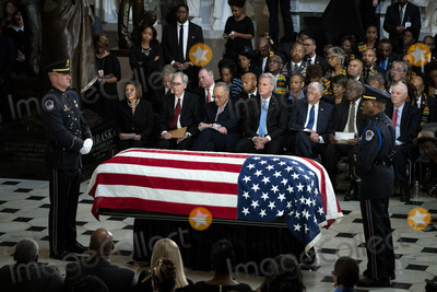 American Flag Photo - The American flag-draped casket of late United States Representative Elijah Cummings (Democrat of Maryland) sits in National Statuary Hall during a memorial service at the US Capitol in Washington DC US on Thursday Oct 24 2019 Cummings a key figure in Democrats impeachment inquiry and a fierce critic of US President Donald J Trump died at the age of 68 on October 17 due to complications concerning long-standing health challenges Seated behind the casket from left to right Speaker of the US House of Representatives Nancy Pelosi (Democrat of California) US Senate Majority Leader Mitch McConnell (Republican of Kentucky) US Senate Minority Leader Chuck Schumer (Democrat of New York) US House Minority Leader Kevin McCarthy (Republican of California) US House Majority Leader Steny Hoyer (Democrat of Maryland) US House Assistant Democratic Leader James Clyburn (Democrat of South Carolina) and US Senator Ben Cardin (Democrat of Maryland)Credit Al Drago  Pool via CNPAdMedia