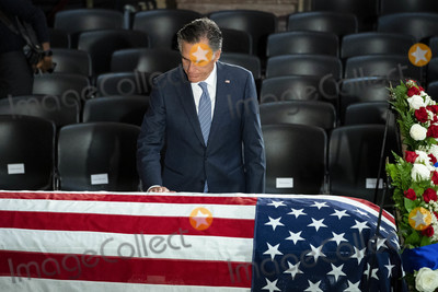 American Flag Photo - United States Senator Mitt Romney (Republican of Utah) pays his respects over the American flag-draped casket of late US Representative Elijah Cummings (Democrat of Maryland) during a memorial service in National Statuary Hall at the US Capitol in Washington DC US on Thursday Oct 24 2019 Cummings a key figure in Democrats impeachment inquiry and a fierce critic of US President Donald J Trump died at the age of 68 on October 17 due to complications concerning long-standing health challenges Credit Al Drago  Pool via CNPAdMedia