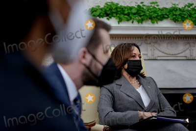 The White Photo - US Vice President Kamala Harris listens during the weekly economic briefing in the Oval Office of the White House in Washington DC US on Friday April 9 2021 Biden proposed major boosts in funding to combat inequality disease and climate change as part of a 152 trillion budget request for 2022 part of his wider push to redefine the role of government in American lives  Credit Amr Alfiky  Pool via CNP