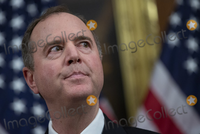 Adam Schiff Photo - United States Representative Adam Schiff (Democrat of California) listens to Speaker of the United States House of Representatives Nancy Pelosi (Democrat of California) as she speaks before the signing which authorized two articles of impeachment to be sent to the United States Senate in the Rayburn Room of the United States Capitol in Washington DC US on Wednesday January 15 2020Credit Stefani Reynolds  CNPAdMedia