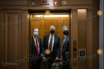Jerry Moran Photo - United States Senator John Barrasso (Republican of Wyoming) left United States Senator Jerry Moran (Republican of Kansas) center and United States Senator Steve Daines (Republican of Montana) board an elevator outside the Senate chamber as the third day of the Senate impeachment trial of former President Donald Trump is adjourned for the day at the US Capitol in Washington DC Thursday February 11 2021 Credit Rod Lamkey  CNPAdMedia