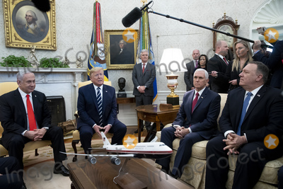 Benjamin Netanyahu Photo - United States President Donald J Trump (C) delivers remarks to members of the news media beside Prime Minister Benjamin Netanyahu of Israel (L) during their meeting in Oval Office of the White House as US Vice President Mike Pence (2-R) and US Secretary of State Mike Pompeo (R) look on in Washington DC USA 27 January 2020 President Trump is expected to unveil a Middle East peace plan during the visit of Prime Minister Netanyahu 28 JanuaryCredit Michael Reynolds  Pool via CNPAdMedia