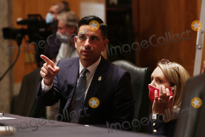 Alex Wong Photo - Acting United States Secretary of Homeland Security Chad F Wolf talks to an aide prior to a hearing before Senate Homeland Security and Governmental Affairs Committee at Dirksen Senate Office Building August 6 2020 on Capitol Hill in Washington DC The committee held a hearing on Oversight of DHS Personnel Deployments to Recent Protests Credit Alex Wong  Pool via CNP