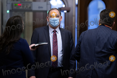 Donald Trump Photo - United States Senator John Boozman (Republican of Arkansas) center wears a protective mask while arriving to the US Capitol in Washington DC US on Saturday Feb 13 2021 The Senate approved 55-45 a request to consider calling witnesses in the second impeachment trial of Donald Trump a move that may extend the trial that was expected to end within hours Credit Stefani Reynolds - Pool via CNPAdMedia