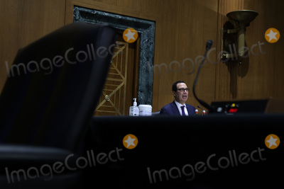 Alex Wong Photo - United States Secretary of the Treasury Steven T Mnuchin testifies before the Congressional Oversight Commission during a hearing titled Examination of Loans to Businesses Critical to Maintaining National Security on Capitol Hill in Washington DC on Thursday December 10 2020Credit Alex Wong  Pool via CNPAdMedia