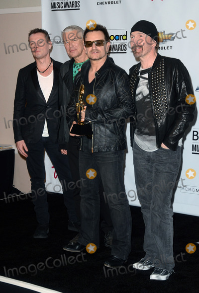 Adam Clayton Photo - 22 May 2011 - Las Vegas Nevada - Larry Mullen Jr Adam Clayton Bono and The Edge of U2 The 2011 Billboard Music Awards Pressroom held at the MGM Grand Garden Arena Photo Credit Tonya WiseAdMedia