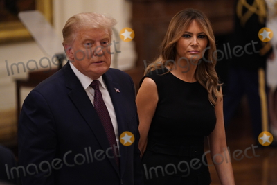 Thomas Payne Photo - United States President Donald Trump and First lady Melania Trump depart the ceremony where the President presented the Medal of Honor to Sergeant Major Thomas Payne United States Army left in the East Room of the White House in Washington DC on September 11 2020 Payne is the 1st living Delta Force member to receive the Medal of Honor Credit Chris Kleponis  Pool via CNPAdMedia