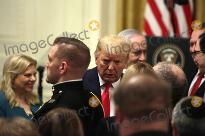 Benjamin Netanyahu Photo - United States President Donald J Trump and Israels Prime Minister Benjamin Netanyahu greet guest after a meeting in the East Room of the White House in Washington DCon Tuesday January 28 2020 Credit Joshua Lott  CNPAdMedia