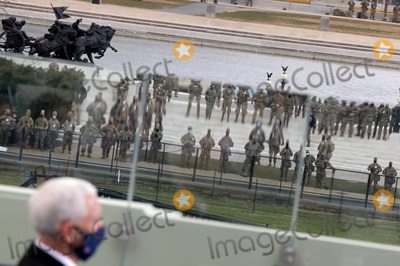 Mike Pence Photo - Security personnel are reflected in glass as US Vice President Mike Pence attends the inauguration of Joe Biden as the 46th President of the United States on the West Front of the US Capitol in Washington US January 20 2021 REUTERSJonathan ErnstPoolAdMedia