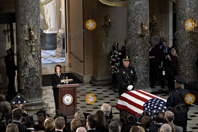 Elijah Cummings Photo - Speaker of the United States House of Representatives Nancy Pelosi (Democrat of California) speaks next to the flag-draped casket of late US Representative Elijah Cummings (Democrat of Maryland) in National Statuary Hall during a memorial service at the US Capitol in Washington DC US on Thursday Oct 24 2019 Cummings a key figure in Democrats impeachment inquiry and a fierce critic of US President Donald J Trump died at the age of 68 on October 17 due to complications concerning long-standing health challenges Credit Al Drago  Pool via CNPAdMedia