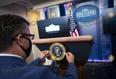 Seal Photo - Communications staff installs the presidential seal on the lectern prior to President Donald Trump delivering remarks on the stock marked and the Dow reaching 30000 for the first time in history at the White House in Washington DC on Tuesday November 24 2020 Credit Kevin Dietsch  Pool via CNPAdMedia