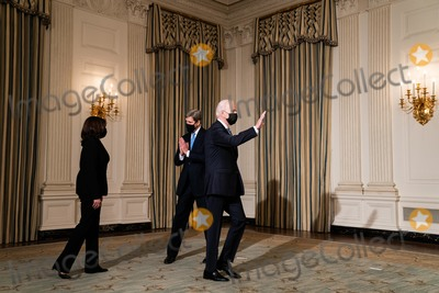 The Specials Photo - John Kerry the Special Presidential Envoy for Climate greets President Joe Biden and Vice President Kamala Harris before the start of an event on the administrations response to climate change at an event in the State Dining Room of the White House in Washington DC January 27th 2021Credit Anna Moneymaker  Pool via CNPAdMedia