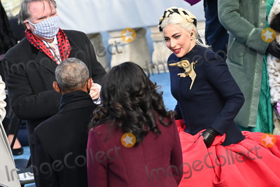 Barack Obama Photo - US singer Lady Gaga talks to Former US President Barack Obama during the Joe Bidens Inauguration ceremony as the 46th US President on January 20 2021 at the US Capitol in Washington DC - Biden a 78-year-old former vice president and longtime senator takes the oath of office at noon (1700 GMT) on the US Capitols western front the very spot where pro-Trump rioters clashed with police two weeks ago before storming Congress in a deadly insurrection (Photo by Saul LOEB  POOL  AFP)AdMedia