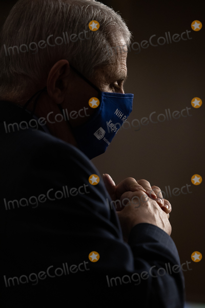 Anthony Fauci Photo - Anthony Fauci director of National Institute of Allergy and Infectious Diseases at NIH looks on during a Senate Health Education and Labor and Pensions Committee on Capitol Hill in Washington Wednesday October 23 2020Credit Graeme Jennings  Pool via CNPAdMedia