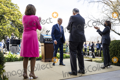 Nancy Pelosi Photo - US President Joe Biden (C-L) along with Speaker of the House Nancy Pelosi (L) Senate Majority Leader Chuck Schumer (C-R) and Vice President Kamala Harris (R) departs after making remarks on the American Rescue Plan from the Rose Garden of the White House in Washington DC USA 12 March 2021 President Biden signed the massive 19 trillion USD coronavirus relief package into law on 11 MarchCredit Jim LoScalzo  Pool via CNPAdMedia