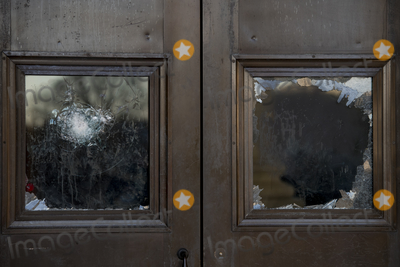 Vandals Photo - Broken windows of the front door of the US Capitol is seen in the aftermath the morning after a riot by pro-Trump supporters who stormed and vandalized the US Capitol as Electoral votes were being counted during a joint session of the United States Congress to certify the results of the 2020 presidential election Washington DC Thursday January 7 2021 Credit Rod Lamkey  CNPAdMedia
