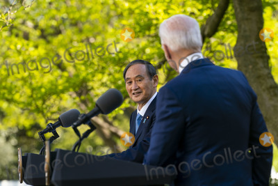 Joe Biden Photo - United States President Joe Biden and The Prime Minister of Japan  HE Suga Yoshihide during a joint news conference at the White House Friday April 16 2021Credit Doug Mills  Pool via CNPAdMedia