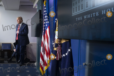 Usher Photo - United States President Donald J Trump arrives to a news conference in the James S Brady Press Briefing Room at the White House in Washington DC US on Monday August 10 2020  Trump was abruptly ushered out of the briefing room by Secret Service after shots were reportedly fired in the area  Credit Stefani Reynolds  CNPAdMedia