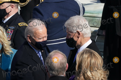 The Ceremonies Photo - Former President Bill Clinton and President Joe Biden spoke after the ceremony Biden was sworn in as the 46th President of the United States on Capitol Hill in Washington DC on January 20 2020 (Erin SchaffThe New York Times NYTINAUGNYTCREDIT Erin SchaffThe New York TimesAdMedia