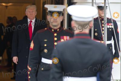 Juanes Photo - United States President Donald J Trump left awaits the arrival of Venezuelan opposition leader Juan Guaido outside the White House in Washington DC US on Wednesday February 5 2020Credit Stefani Reynolds  CNPAdMedia