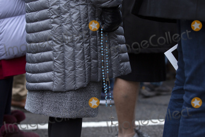 The National Photo - A woman holds a rosary as she walks in the March for Life on the National Mall in Washington DC US on Friday January 24 2020Credit Stefani Reynolds  CNPAdMedia