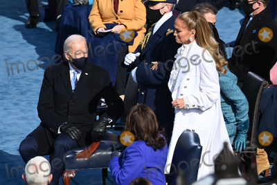 JENNIFER LOPEZ Photo - US Singer Jennifer Lopez arrives to sing at the Inauguration ceremony of Joe Biden as the 46th US President on January 20 2021 at the US Capitol in Washington DC - Biden a 78-year-old former vice president and longtime senator takes the oath of office at noon (1700 GMT) on the US Capitols western front the very spot where pro-Trump rioters clashed with police two weeks ago before storming Congress in a deadly insurrection (Photo by Saul LOEB  POOL  AFP)AdMedia