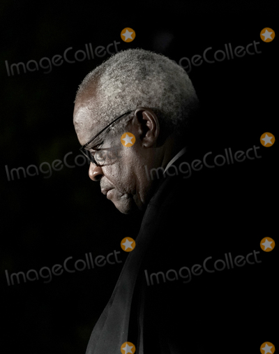 Supremes Photo - Associate Justice of the Supreme Court Clarence Thomas waits to administer the oath of office to Judge Amy Coney Barrett to be Associate Justice of the Supreme Court outside the Diplomat Room of the White House in Washington DC US October 26 2020 Credit Ken CedenoPool via CNPAdMedia