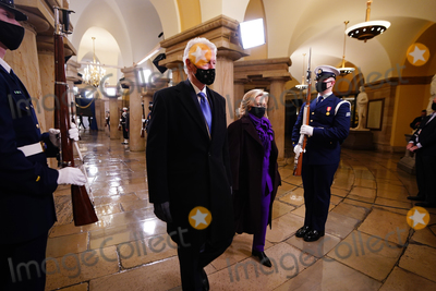 Bill Clinton Photo - Former President Bill Clinton (L) and former Secretary of State Hillary Clinton arrive in the Crypt of the US Capitol for President-elect Joe Bidens inauguration ceremony to be the 46th President of the United States in Washington DC USA 20 January 2021AdMedia