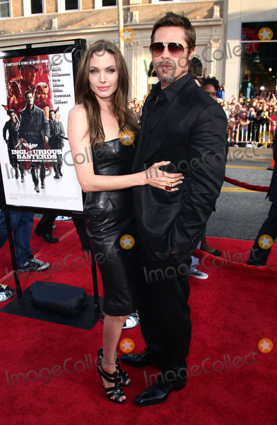 Graumans Chinese Theatre Photo - 20 September 2016 - Los Angeles CA - Angelina Jolie Pitt has filed for divorce from Brad Pitt Jolie Pitt 41 filed legal docs Monday citing irreconcilable differences Jolie Pitt requested physical custody of the couples shared six children  Maddox Pax Zahara Shiloh Vivienne and Knox  asking for Pitt to be granted visitation citing legal documents File Photo 10 August 2009 - Hollywood California - Brad Pitt and Angelina Jolie Inglourious Basterds Los Angeles Premiere held at Graumans Chinese Theatre Photo Credit T ConradAdMedia