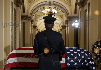 Alex Wong Photo - An honor guard stands next to the flag-draped casket of United States Representative Elijah Cummings (Democrat of Maryland) as the late congressman lies in state outside the US House chamber at the US Capitol October 24 2019 in Washington DC Rep Cummings passed away on October 17 2019 at the age of 68 from complications concerning longstanding health challenges  Credit Alex Wong  Pool via CNPAdMedia