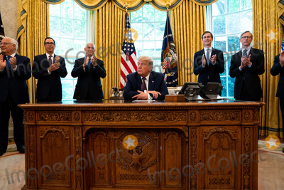 Brian Hooks Photo - Cabinet members and Foreign Service Officers applaud after United States President Donald J Trumps announcement that Bahrain would normalize relations with Israel in the Oval Office at the White House in Washington DC on September 11 2020  From left to right David Friedman US Ambassador to Israel US Secretary of the Treasury Steven T Mnuchin US Vice President Mike Pence President Trump Jared Kushner Assistant to the President and Senior Advisor and Brian Hook former US Special Representative for Iran and Senior Advisor to the Secretary of StateCredit Anna Moneymaker  Pool via CNPAdMedia