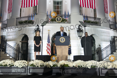 The Ceremonies Photo - United States President Donald J Trump participates in the ceremonial swearing-in of Amy Coney Barrett as Supreme Court at the White House in Washington DC October 26 2020 From left to right Judge Amy Coney Barrett President Trump Associate Justice Clarence Thomas Credit Chris Kleponis  Pool via CNPAdMedia