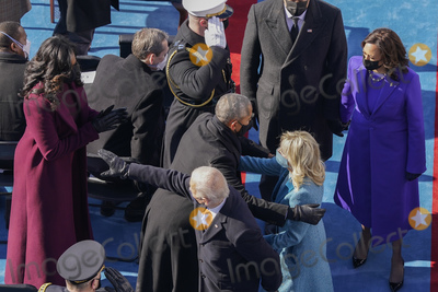 President Barack Obama Photo - President Joe Biden and first lady Jill Biden with former President Barack Obama and Michelle Obama as they leave the stage at the 59th Presidential Inauguration at the US Capitol in Washington Wednesday Jan 20 2021 Walking behind Biden is Vice President Kamala Harris and her husband Doug Emhoff (AP PhotoSusan Walsh Pool)AdMedia