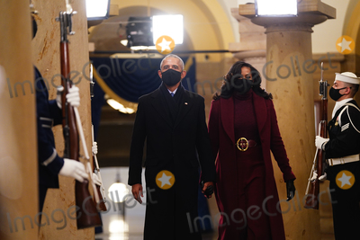 Michelle Obama Photo - Former US President Barack Obama (L) and Michelle Obama arrive in the Crypt of the US Capitol for President-elect Joe Bidens inauguration ceremony to be the 46th President of the United States in Washington DC USA 20 January 2021AdMedia