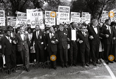 Martin Luther King Jr Photo - Reverend Dr Martin Luther King Jr 4th from left and other civil rights leaders hold hands as they lead a crowd of hundreds of thousands at the March on Washington for Jobs and Freedom Washington DC August 28 1963 from left to right John Lewis Mathew Ahmann unidentified Dr King unidentified unidentified Rabbi Joachim Prinz unidentified and Whitney YoungCredit Arnie Sachs  CNPAdMedia