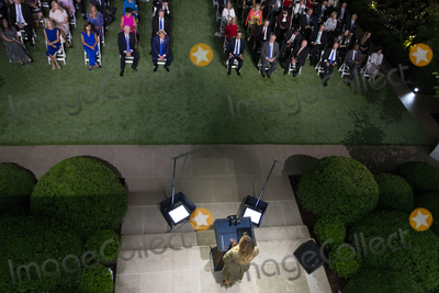 Front Row Photo - First lady Melania Trump (Bottom) delivers a speech during the second night of the Republican National Convention as United States President Donald J Trump (Top C) looks on in the Rose Garden of the White House in Washington DC USA 25 August 2020  Those sitting in the front row include from left to right Senior Counselor Kellyanne Conway Karen Pence US Vice President Mike Pence US President Donald J Trump US Secretary of the Treasury Steven T Mnuchin US Secretary of the Interior David Bernhardt US Secretary of Agriculture Sonny Perdue US Secretary of Commerce Wilbur L Ross Jr and US Secretary of Housing and Urban Development (HUD) Ben Carson  Also seated in the second row behind the President and Vice President are Melanias parents Amalija Knavs and Viktor KnavsCredit Michael Reynolds  Pool via CNPAdMedia