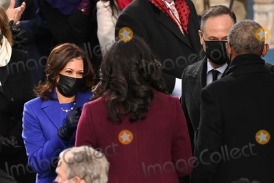 First Lady Michelle Obama Photo - US Vice President-elect Kamala Harris (L) salutes Former US First Lady Michelle Obama as US Second Gentleman Doug Emhoff (2nd R) meets Former US President Barack Obama before US President-elect Joe Biden is sworn in as the 46th US President on January 20 2021 at the US Capitol in Washington DC - Biden a 78-year-old former vice president and longtime senator takes the oath of office at noon (1700 GMT) on the US Capitols western front the very spot where pro-Trump rioters clashed with police two weeks ago before storming Congress in a deadly insurrection (Photo by Saul LOEB  POOL  AFP)AdMedia