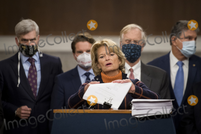 Alaska  Photo - United States Senator Lisa Murkowski (Republican of Alaska) joins a bipartisan group of US Senators announcing the legislative text of the two bipartisan bicameral COVID-19 emergency relief bills that propose to provide up to 908 billion in emergency relief on Capitol Hill in Washington DC on Monday December 14 2020  The first will allocate 748 billion for more PPP assistance and an unemployment benefit and a second 160 billion bill to provide aid for state and local governments and liability protections for businessesCredit Rod Lamkey  CNP