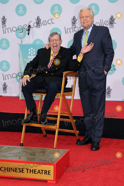 TCL Chinese Theatre Photo - 20 August 2017 - Jerry Lewis the brash slapstick comic who became a pop culture sensation in his partnership with Dean Martin and then transformed himself into an auteur filmmaker of such comedic classics as The Nutty Professor and The Bellboy has died in Las Vegas at the age of 91 For most of his career Lewis was a complicated and sometimes polarizing figure An undeniable comedic genius he pursued a singular vision and commanded a rare amount of creative control over his work with Paramount Pictures and other studios He legacy also includes more than 25 billion raised for the Muscular Dystrophy Association through the annual Labor Day telethon that he made an end-of-summer ritual for decades until he was relieved of the hosting job in 2011 In addition to his most famous films Lewis also appeared in a number of notable works such as Martin Scorseses The King of Comedy but was largely offscreen from the late 60s on and was more active with his telethon and philanthropic efforts As late as 2016 Lewis continued to perform in Las Vegas where he first debuted his comedy routine back in 1949 File Photo 12 April 2014 - Hollywood California - Jerry Lewis Robert Osborne 2014 TCM Classic Film Festival - Jerry Lewis Hand  Footprint Ceremony held at the TCL Chinese Theatre Photo Credit Byron PurvisAdMedia