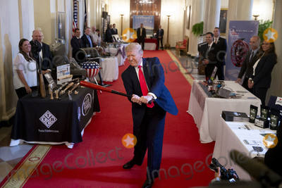 White House Photo - US President Donald J Trump swings a baseball bat made by Texas Timber Bat Company while participating in the Spirit of America Showcase at the White House in Washington DC USA 02 July 2020 The event is a showing of American products ahead of 04 July Independence Day Photo Credit Michael ReynoldsCNPAdMedia