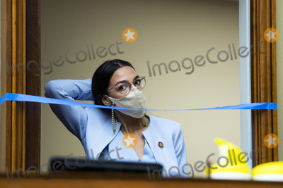 Alexandria Ocasio-Cortez Photo - United States Representative Alexandria Ocasio-Cortez (Democrat of New York) arrives as US Postmaster General Louis DeJoy testifies during the US House Oversight and Reform Committee hearing titled Protecting the Timely Delivery of Mail Medicine and Mail-in Ballots in Rayburn House Office Building on Monday August 24 2020Credit Tom Williams  Pool via CNPAdMedia
