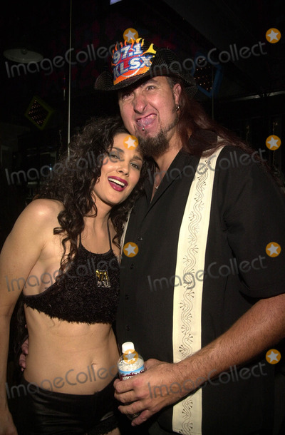 Julie Strain Photo - Julie Strain with seven foot tall Big Mike at the Tres De Mayo listener party for Los Angeles Radio Station KLSX 971 held at Camachos City of Industry 05-03-02